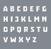 Alfabet i pappers- stil Arkivfoto