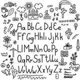 Alfabet met krabbels wordt geplaatst die Stock Foto