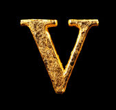 Alfabet och nummer i bladguld Arkivfoto