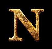 Alfabet och nummer i bladguld Arkivbild