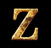 Alfabet och nummer i bladguld Arkivfoton