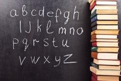 Alfabet op een bord Stock Fotografie