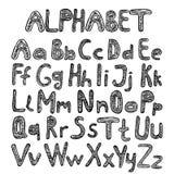 Alfabet op zwarte rugplank royalty-vrije illustratie