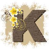 alfabet poślubnika k żółty Zdjęcia Royalty Free