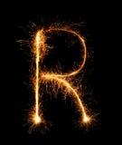 Alfabet R (versalar) för tomteblossfyrverkeriljus på natten Fotografering för Bildbyråer