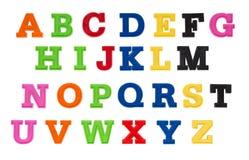 Alfabet som är skriftligt i mångfärgade plast-ungebokstäver Royaltyfri Fotografi