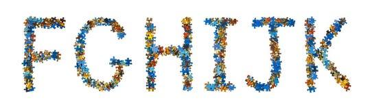 Alfabet som göras av pusselstycken - utbildningsbegrepp Royaltyfria Bilder