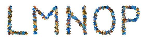 Alfabet som göras av pusselstycken - utbildningsbegrepp Arkivbild