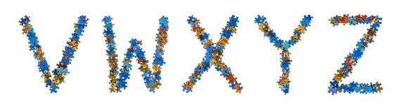 Alfabet som göras av pusselstycken - utbildningsbegrepp Arkivbilder