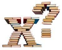 Alfabet som göras ut ur böcker, bokstäver X och frågefläck Royaltyfria Bilder