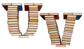 Alfabet som göras ut ur böcker, bokstäver U och V Royaltyfri Fotografi