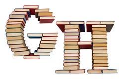 Alfabet som göras ut ur böcker, bokstavsG och H Royaltyfri Bild