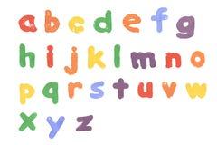 Alfabet som skrivs ut på vit bakgrund Royaltyfria Foton