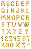 Alfabet van fruit op een witte achtergrond royalty-vrije stock afbeeldingen