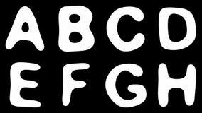 Alfabet van goud op zwarte achtergrond wordt geïsoleerd die stock video