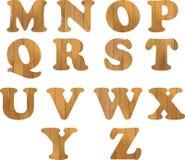 Alfabet van houten brieven op witte achtergrond wordt gemaakt die Stock Afbeeldingen
