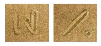 Alfabet W-X på sand Royaltyfri Fotografi