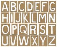 Alfabetbrieven van kartondocument dat worden gemaakt Stock Afbeeldingen