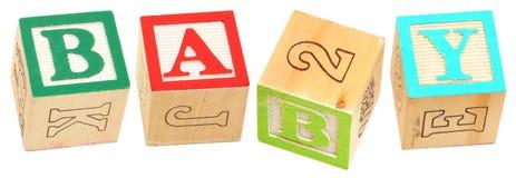 alfabetet behandla som ett barn block Arkivfoto