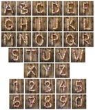 Alfabetet märker och nummer som göras från vinkorkar Royaltyfri Fotografi