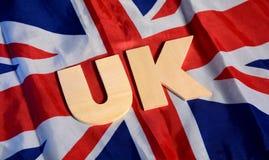 Alfabeti BRITANNICI con la bandiera del Regno Unito nel fondo Fotografia Stock Libera da Diritti