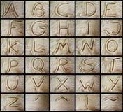 Alfabeti nella sabbia Immagini Stock Libere da Diritti