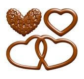 Alfabetletters, getallen en symbolen van chocoladestroop worden gemaakt op geïsoleerde witte achtergrond die Royalty-vrije Stock Afbeeldingen
