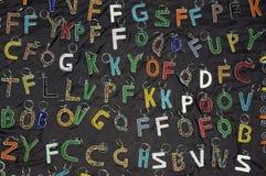 Alfabeto africano dei portachiavi a anello di arte Fotografie Stock