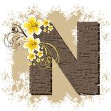 Alfabeto amarillo N de la vendimia del hibisco Fotos de archivo