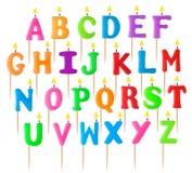 Alfabeto bajo la forma de velas ardientes Imagen de archivo libre de regalías