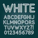 Alfabeto bianco e numeri della metropolitana al neon Fotografie Stock Libere da Diritti
