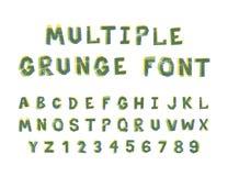 Alfabeto brilhante múltiplo da fonte do grunge das cores no branco fotos de stock royalty free