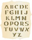 Alfabeto céltico en el papel viejo Foto de archivo