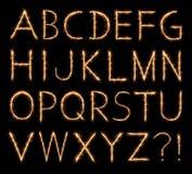 Alfabeto chispeante Imagenes de archivo