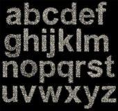 Alfabeto chispeante hecho de las estrellas brillantes, letras Imágenes de archivo libres de regalías