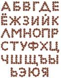 Alfabeto cir?lico hecho de los granos de caf Imagenes de archivo