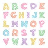 Alfabeto con los puntos de polca en colores pastel Fotografía de archivo