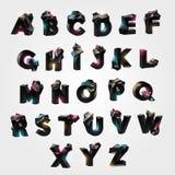 Alfabeto con salientes geométricas teseladas Imagenes de archivo