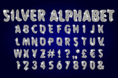 Alfabeto d'argento su un fondo scuro Immagini Stock Libere da Diritti