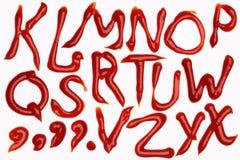 Alfabeto da ketchup de tomate Fotos de Stock