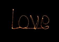 Alfabeto da luz do fogo de artifício do chuveirinho do amor Fotografia de Stock