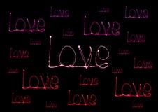 Alfabeto da luz do fogo de artifício do chuveirinho do amor Imagem de Stock Royalty Free