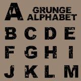 Alfabeto de Grunge fijado [A-M] ilustración del vector