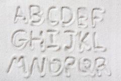 Alfabeto de la arena Fotos de archivo