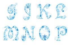 Alfabeto de la Navidad con los copos de nieve Fotos de archivo