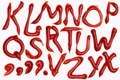 Alfabeto de la salsa de tomate de tomate Fotos de archivo