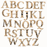 Alfabeto de la vendimia basado en el periódico viejo Fotografía de archivo