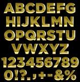 Alfabeto de las letras y de los números del oro Foto de archivo libre de regalías