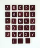 Alfabeto de madeira com telhas vazias Fotografia de Stock
