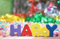 Alfabeto de madera colorido feliz Foto de archivo